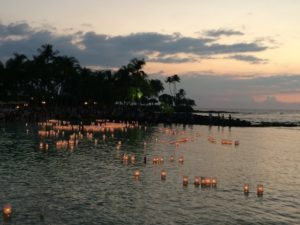 Floating lanterns created by loved ones of the deceased float out in the calm Hawaii waters.  This event is a regular hosted by North Hawaii Hospice in addition to the first ever death doula training in Hawaii
